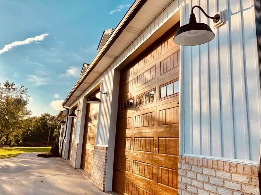 The Redondo Gooseneck Barn Light Fixtures on exterior garage.
